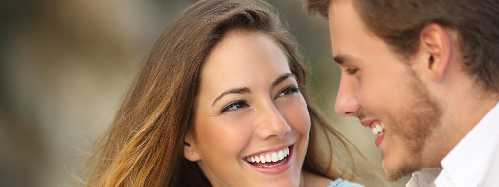 Young couple smiling side